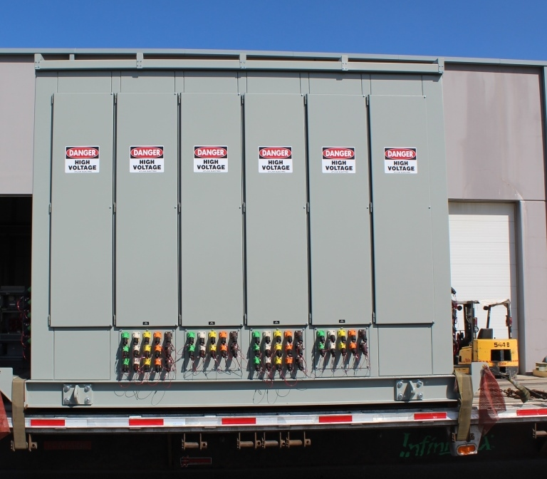 Skid mounted low voltage outdoor walk-in switch-house